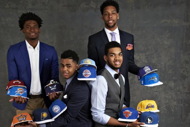 2015 Lottery picks pose with hats from their potential suitors.